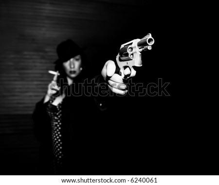 Woman spy aiming handgun smoking a cigarette.