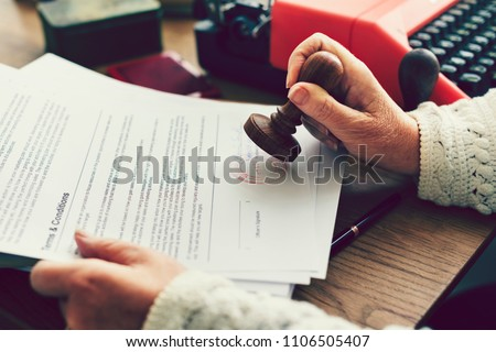 Woman stamping an official document