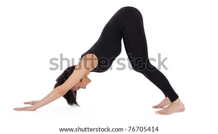 woman stand in yoga asana - Downward Facing Dog