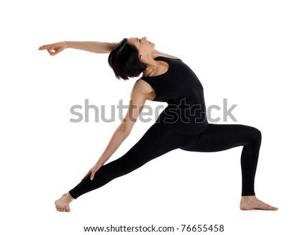 woman stand in yoga pose - warrior asana