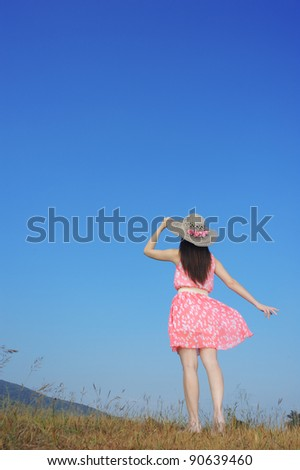 Woman standing and  sky - stock photo