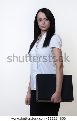 woman standing holing a box folder in her hands ready for work