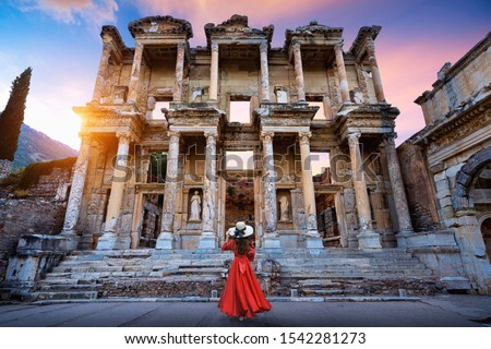 Woman standing in Celsus Library at Ephesus ancient city in Izmir, Turkey.
