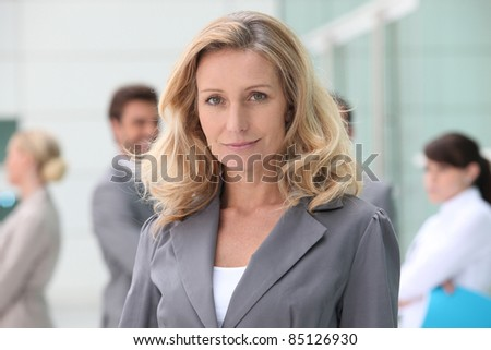 Woman standing in front of her colleagues