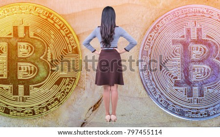 woman standing in the middle of a pile of coins. of Bitcoin Cash, a Cryptocurrency blockchain, Digital money, Golden Bitcoin currency on wood background.  High resolution photo.