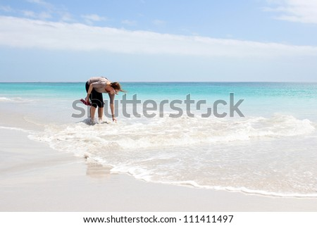 Woman standing in Water at the Beach of Kommetjie