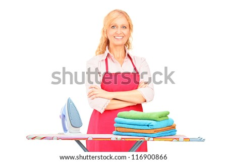 Woman standing next to an ironing board isolated on white background