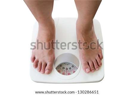 Woman Standing on Digital Weighing Apparatus show 50 kg.
