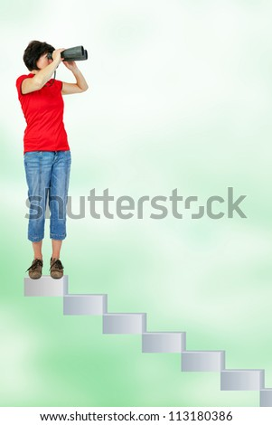 Woman standing on stairs and looking through the binoculars