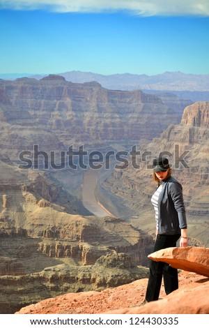 Woman standing on the edge of Grand Canyon.Arizona. USA