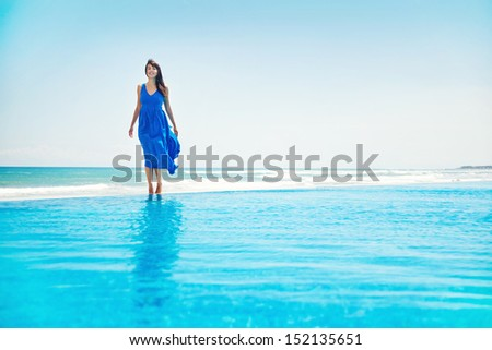 woman standing on the infinite water - freedom concept #152135651