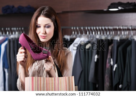 Woman stares at excellent fuchsia shoes at shopping center