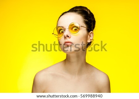 Woman staring eyes looking at the camera - Shutterstock ID 569988940
