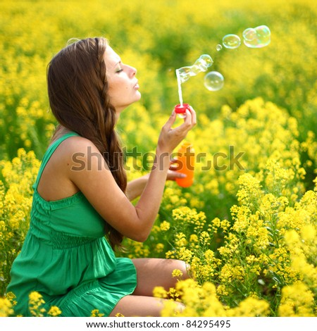 woman start soap bubbles - stock photo