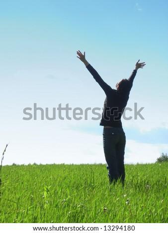 woman stay in field under blue sky