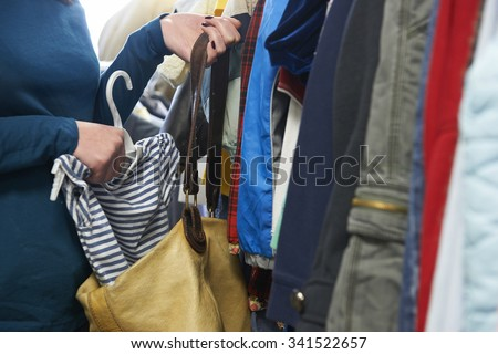 Woman Stealing Clothes From Store Сток-фото ©