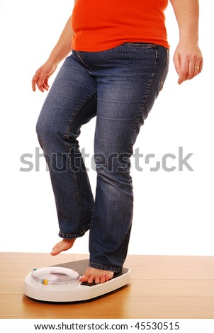 Woman stepping on weighing scales