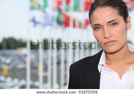 Woman stood in front of various national flags