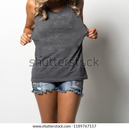 Woman Stretching a Dark Gray Tank Top