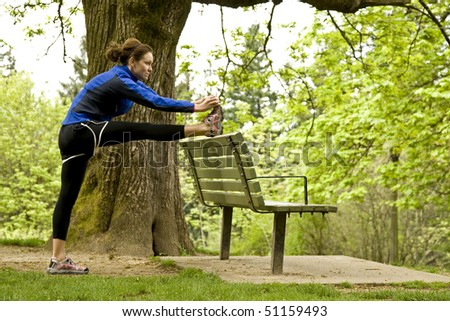 Woman stretching on a park bench.