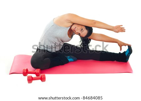 Woman stretching on red mat over white background - stock photo