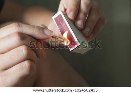 Woman striking a match Stock photo ©