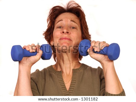 Woman struggles with two 5 lbs. weights