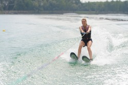 woman study waterskiing on a lake