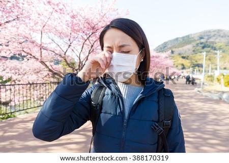 Woman suffer from allergy from pollen allergy at sakura season