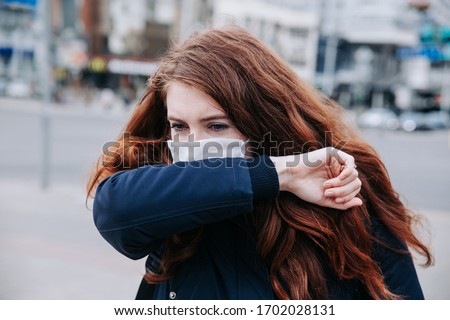 Woman suffer from sick and wearing face mask. European woman in protective mask feeling bad on the street in the city ストックフォト ©