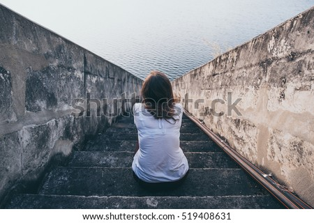 Shutterstock woman suffering from  fear, loneliness, depression, abuse, addiction