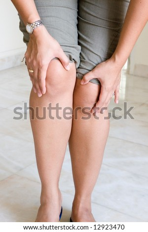 Woman suffering painful knee joint