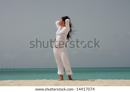 Woman, sun and ocean. Young beautiful brunette woman enjoying sun and ocean during her Caribbean vacation.