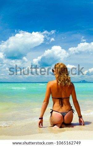 woman sunbathign at the  tropical beach #1065162749