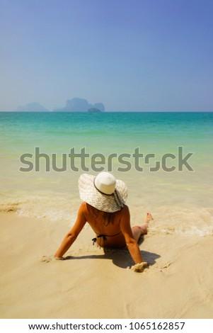 woman sunbathign at the  tropical beach #1065162857