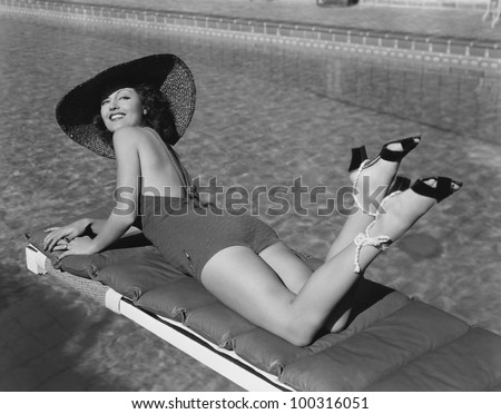 Woman sunbathing at pool