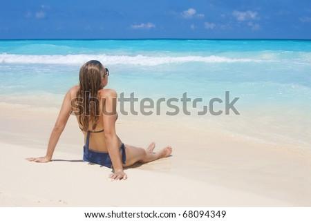 Woman Sunbathing on a Beach Vacation