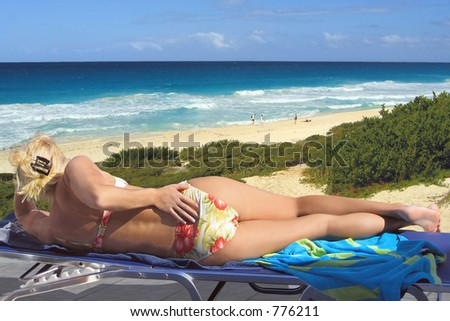 Woman suns herself at the beach