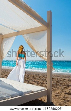 Woman suntanning - summer holidays at the tropical beach #1182260203