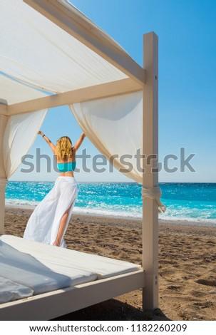Woman suntanning - summer holidays at the tropical beach #1182260209