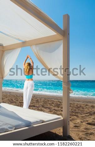 Woman suntanning - summer holidays at the tropical beach #1182260221