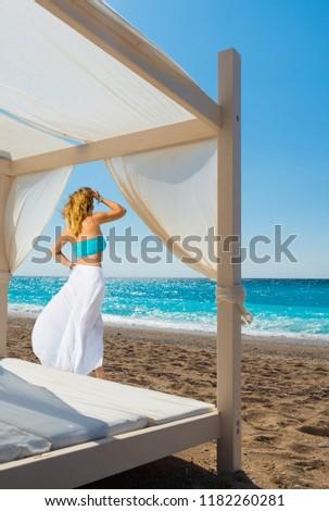 Woman suntanning - summer holidays at the tropical beach #1182260281