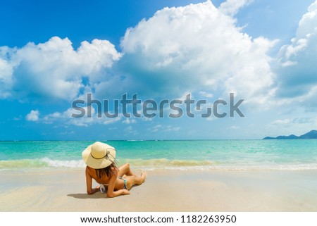 Woman suntanning - Winter holidays at the tropical beach #1182263950