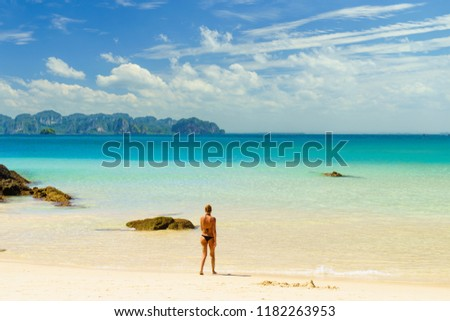 Woman suntanning - Winter holidays at the tropical beach #1182263953