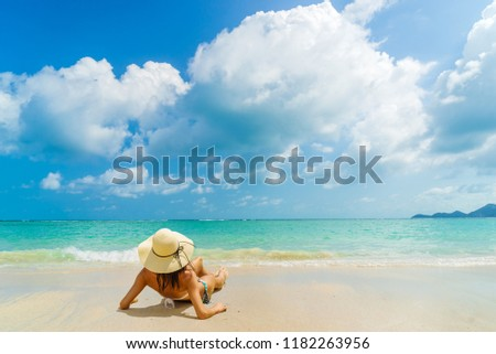 Woman suntanning - Winter holidays at the tropical beach #1182263956