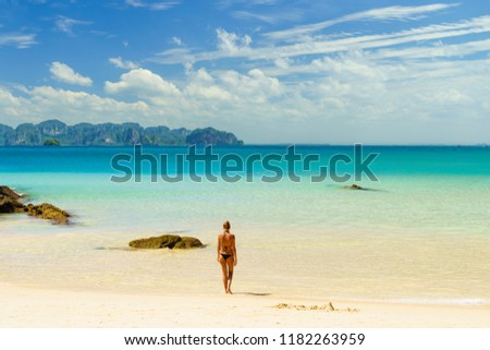 Woman suntanning - Winter holidays at the tropical beach #1182263959