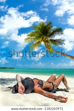 Woman suntanning - Winter holidays at the tropical beach #1182263971