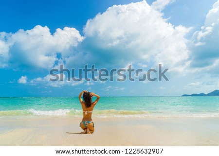 Woman suntanning - Winter holidays at the tropical beach #1228632907