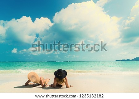 Woman suntanning - Winter holidays at the tropical beach #1235132182