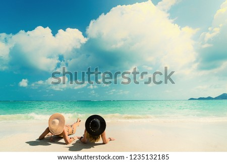 Woman suntanning - Winter holidays at the tropical beach #1235132185